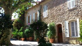 Quiet Courtyard. Nature and provençal architecture combine to create this peaceful, quiet and lazy summer afternoon ambiance in the village of Grimaud, France Royalty Free Stock Images