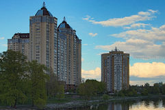Quiet and cozy area on the left side of the Dnieper River in Kiev. Multi-storey buildings. Cloudy spring day Royalty Free Stock Image