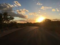 Quiet desert road sunset, Arizona Stock Photos