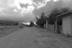 Quiet dirt road in rural farming village, Mexico Stock Photo