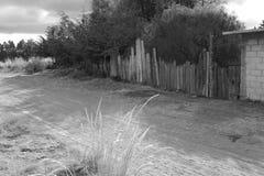Quiet dirt road in rural farming village, Mexico Stock Images