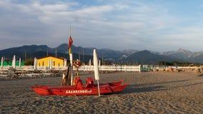 Quiet evening on the beach at Marinella, Massa Carrara, Italy. The Lifeguard boat and area is also closed. Apuan Alps. Quiet evening on the beach at Marinella royalty free stock photo