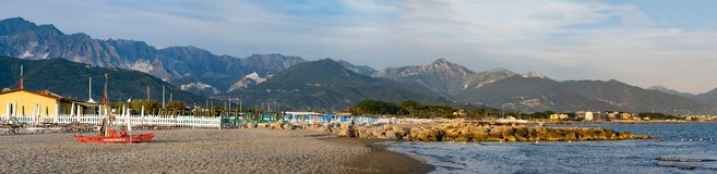 Quiet evening on the beach at Marinella, Massa Carrara, Italy. The Lifeguard station is deserted. The Apuan Alps can be. Seen in the background stock photography