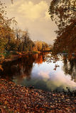 A quiet evening in a city Park painted in bright colors of autumn Royalty Free Stock Photography