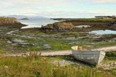 Quiet fjord scene. Shabby boat at the shore of Stykkisholmur fjord in Iceland Stock Image