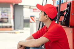 Quiet gas station no customers staff worker sitting idle work during the COVID-19 outbreak