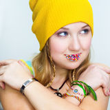 The quiet girl with candies on lips Royalty Free Stock Photo