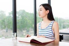 Quiet girl reading in coffee shop Stock Photos