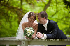 Quiet happiness. Beautiful bride and groom leaning over the railing for a quiet moment of happiness Stock Photography