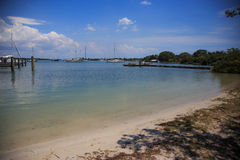 Quiet harbor. The view of boats and the beach Royalty Free Stock Photos