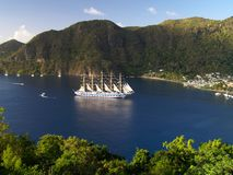 Quiet haven. Tall sail ship in a small bay of tropical island Royalty Free Stock Photos