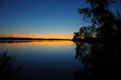 Quiet Karelian sunset. The final stage of a sunset above the huge lake in Karelia region. The picture is colorful and relaxing stock photography