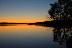 Quiet Karelian sunset. The final stage of a sunset above the huge lake in Karelia region. The picture is colorful and relaxing royalty free stock image
