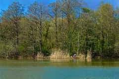 Quiet lake and fisherman Royalty Free Stock Images