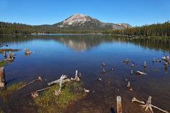 A quiet lake in the mountains Stock Images
