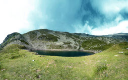 Quiet lake on the peak of mountains. Carpathians mountains, Iezer Lake, Romania Stock Image