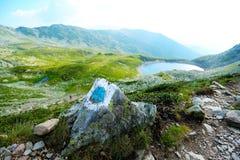 Quiet lake on the peak of mountains. Carpathians mountains, Romania Stock Image