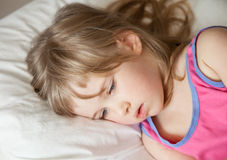 Quiet little girl in a bed Royalty Free Stock Photos