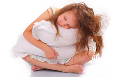 Quiet little girl with a pillow Royalty Free Stock Image