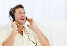 Quiet man listening music on the sofa Royalty Free Stock Photography