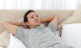 Quiet man relaxing on his bed Stock Image