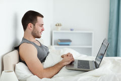 Quiet man using a laptop Royalty Free Stock Photography