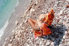 Quiet moments on a rocky Adriatic beach Stock Photos
