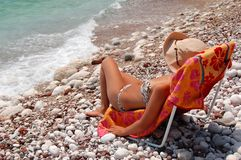 Quiet moments on a rocky Adriatic beach Stock Photography