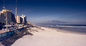 A quiet morning on the beach. Photo taken during winter 2016 in Florida. The sky was blue and it was calm. The tide was rising slowly. Daytona Beach, Florida, U stock images