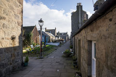 A quiet North Square walking street with old granite houses next to the sea and beach in Aberdeen city Royalty Free Stock Photos