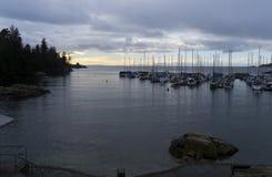 Quiet ocean bay with small marina Stock Photo