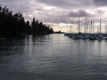 Quiet ocean bay with small marina Stock Photos
