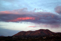 Quiet pastel pink and blue sunset over the Tucson mountains. Royalty Free Stock Images