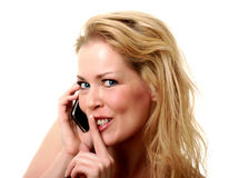Quiet please. Blond girl needing some silence while on the phone Royalty Free Stock Images