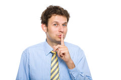 Quiet please, finger on his lips, isolated Royalty Free Stock Photography