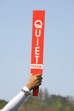 The quiet please sign was held up by volunteer in golf tournamen Royalty Free Stock Photo