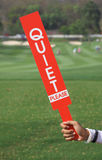 Quiet please sign was shown by staff in golf tournament. Stock Images