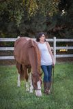 Quiet Reflections. A quiet, reflective moment with her horse stock image
