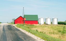 Rural Red Farmhouse Barn and Silos royalty free stock images