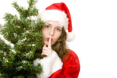 Quiet Santa Claus Woman beside Christmas fir tree stock photography