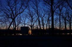 Free Quiet Scene Of A Camper In The Forest At Dusk. Stock Photography - 114180862