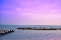 A quiet sea near the evening. With a wave barrier Royalty Free Stock Photos