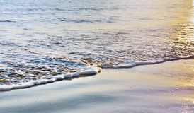 Quiet sea with sunshine colors on the surface of the water. At low tide royalty free stock photos