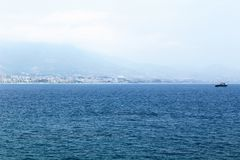 Quiet sea surface and city landscape in the distance Alanya, Turkey.  Royalty Free Stock Photos
