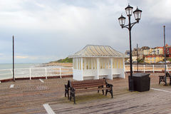 Quiet seaside pier. A shelter on a seaside pier. There is rain and the pier is very quiet with most people staying away. Taken in the summer at the pier in stock images