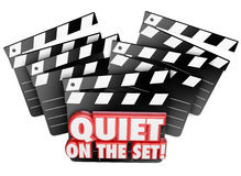 Quiet on the Set Movie Film Making Production Soundstage. Quiet on the Set words in 3d letters on a film making, movie production clapper board for a shoot or Stock Photo