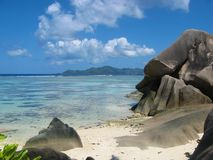 Quiet Seychelles beach. View between the famous granite rocks onto the Indian Ocean of La Digue island, Seychelles Stock Photos