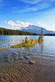 Quiet shallow lake in Banff National Park Stock Images
