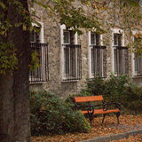 Quiet shop. Fall time reflections. Bench in a quiet street. Calmness, reliability, comfort Royalty Free Stock Images