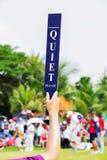 Quiet sign in golf tournament. Volunteer holds up a Quiet sign in golf tournament Royalty Free Stock Photo
